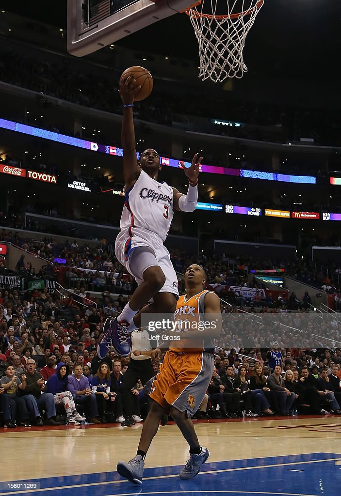 Chris Paul #3 of the Los Angeles Clippers drives to the basket past Sebastian Telfair #31 of the Phoenix Suns for a layup in the second half at Staples Center on December 8, 2012 in Los Angeles, California. The Clippers defeated the Suns 117-99.