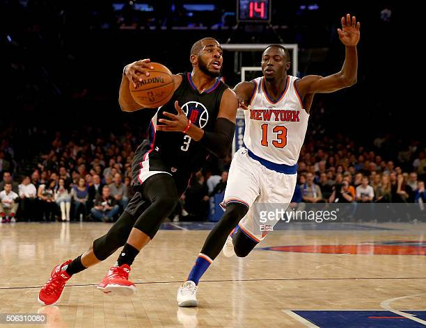 Chris Paul of the Los Angeles Clippers drives to the net as Jerian Grant of the New York Knicks defends at Madison Square Garden on January 22 2016...