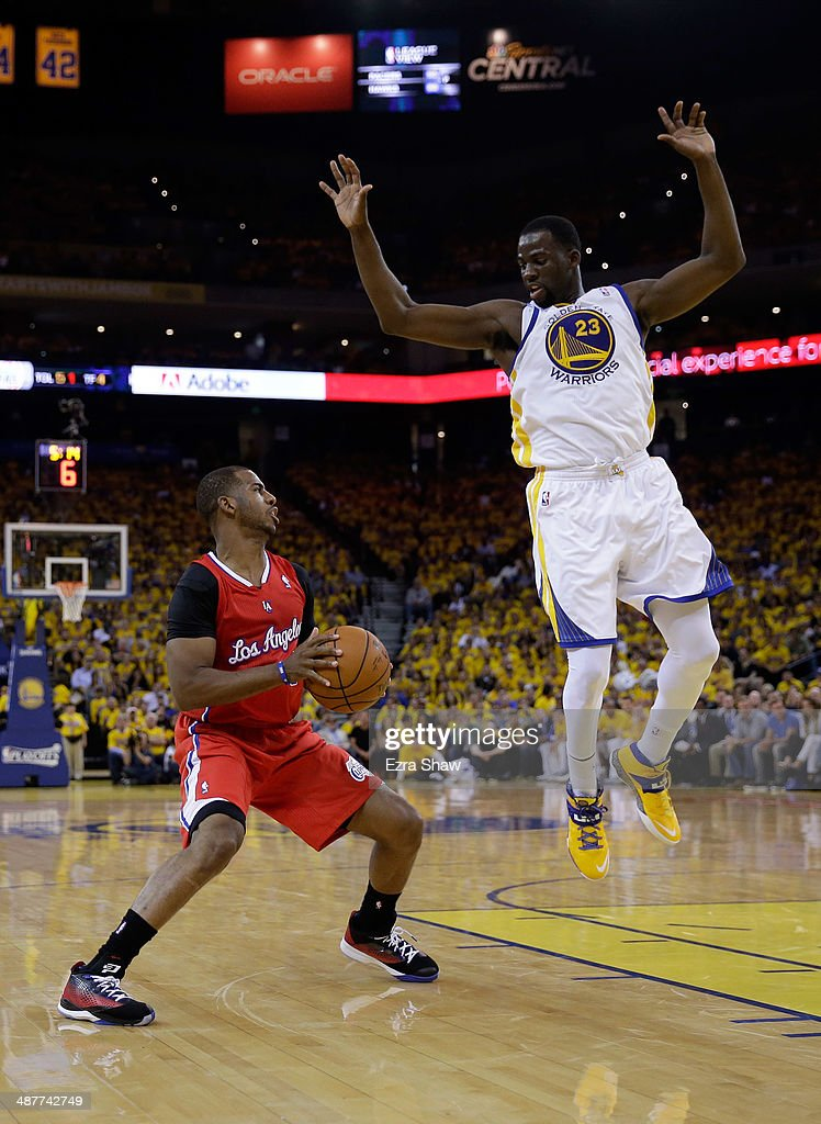 Chris Paul #3 of the Los Angeles Clippers fakes out Draymond Green #23 of the Golden State Warriors in Game Six of the Western Conference Quarterfinals during the 2014 NBA Playoffs at ORACLE Arena on May 1, 2014 in Oakland, California.
