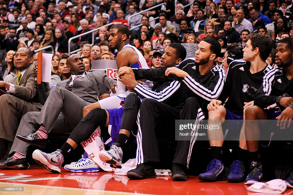 Chris Paul #3 of the Los Angeles Clippers falls into the Sacramento Kings bench during a game at Staples Center on December 21, 2012 in Los Angeles, California.