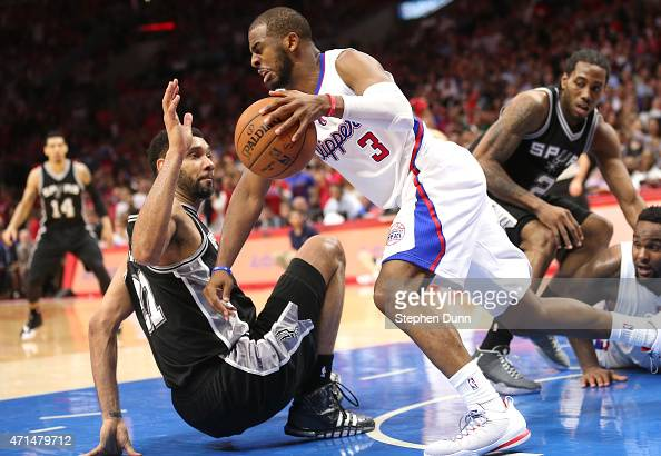 Chris Paul of the Los Angeles Clippers gets control of a loose ball over Tim Duncan of the San Antonio Spurs during Game Five of the Western...