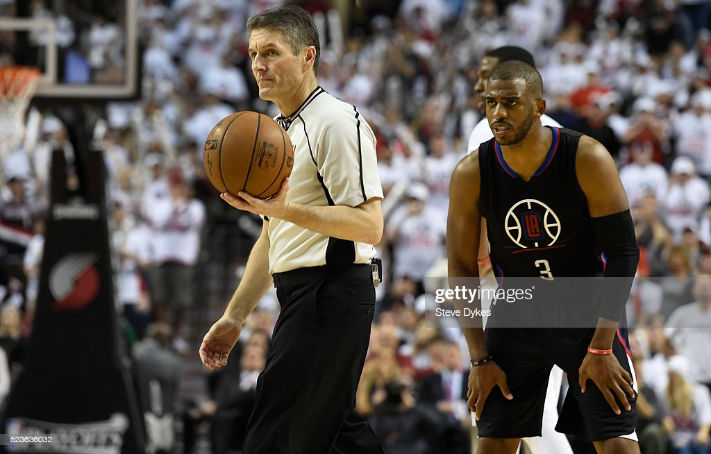 Chris Paul of the Los Angeles Clippers glares at referee Scott Foster after receiving a technical foul in the third quarter of Game Three of the...
