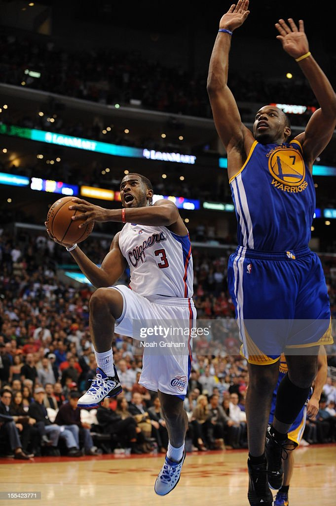 Chris Paul #3 of the Los Angeles Clippers goes to the basket against Carl Landry #7 of the Golden State Warriors during the game between the Los Angeles Clippers and the Golden State Warriors at Staples Center on November 3, 2012 in Los Angeles, California.