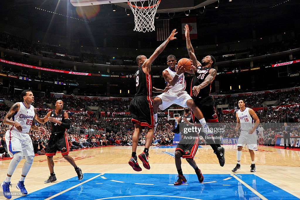 <a gi-track='captionPersonalityLinkClicked' href=/galleries/search?phrase=Chris+Paul&family=editorial&specificpeople=212762 ng-click='$event.stopPropagation()'>Chris Paul</a> #3 of the Los Angeles Clippers goes to the basket against <a gi-track='captionPersonalityLinkClicked' href=/galleries/search?phrase=Rashard+Lewis&family=editorial&specificpeople=201713 ng-click='$event.stopPropagation()'>Rashard Lewis</a> #9 and <a gi-track='captionPersonalityLinkClicked' href=/galleries/search?phrase=Udonis+Haslem&family=editorial&specificpeople=201748 ng-click='$event.stopPropagation()'>Udonis Haslem</a> #40 of the Miami Heat at the Staples Center on November 14, 2012 in Los Angeles, California.