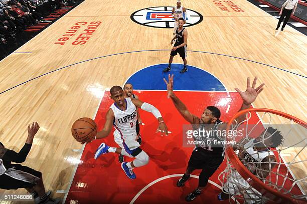 Chris Paul of the Los Angeles Clippers goes to the basket against Tim Duncan of the San Antonio Spurs on February 18 2016 at STAPLES Center in Los...