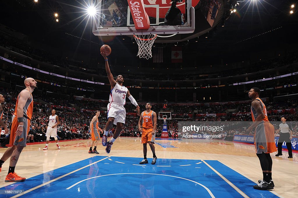 Chris Paul #3 of the Los Angeles Clippers goes up for a layup against the Phoenix Suns at Staples Center on December 8, 2012 in Los Angeles, California.