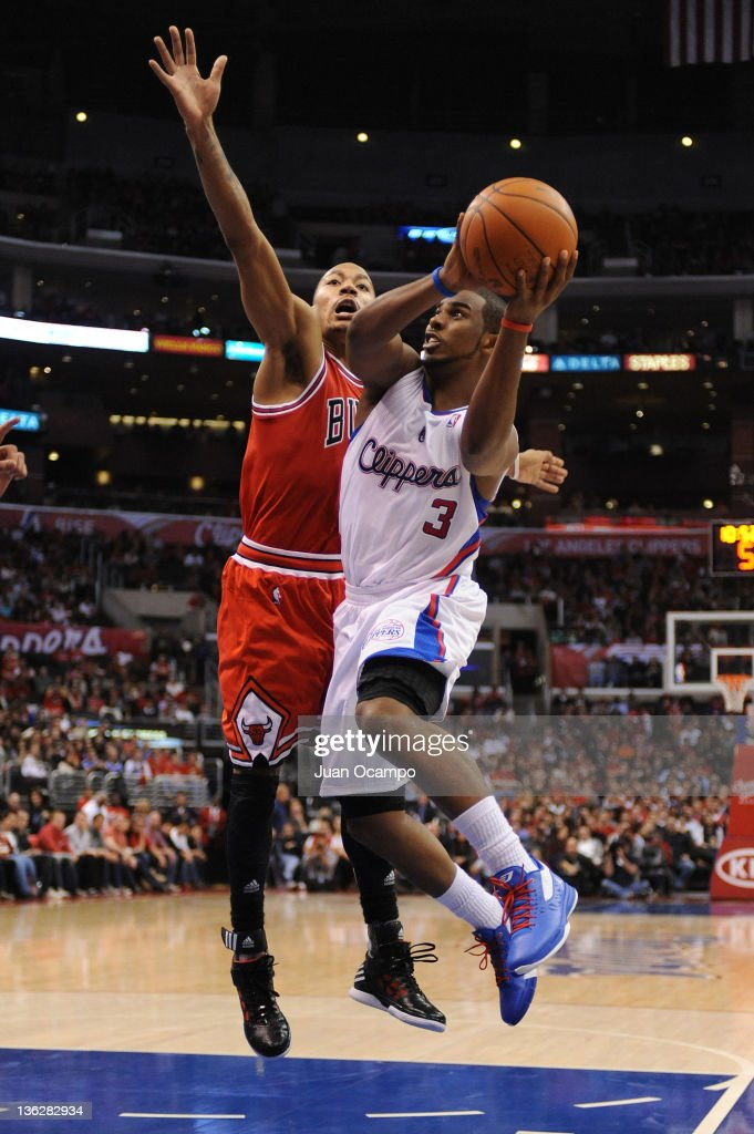 Chris Paul of the Los Angeles Clippers goes up for a shot against Derrick Rose of the Chicago Bulls at Staples Center on December 30 2011 in Los...