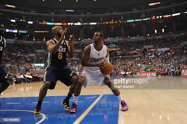 Chris Paul of the Los Angeles Clippers goes up for the shot against Jamaal Tinsley of the Utah Jazz at Staples Center on February 23 2013 in Los...