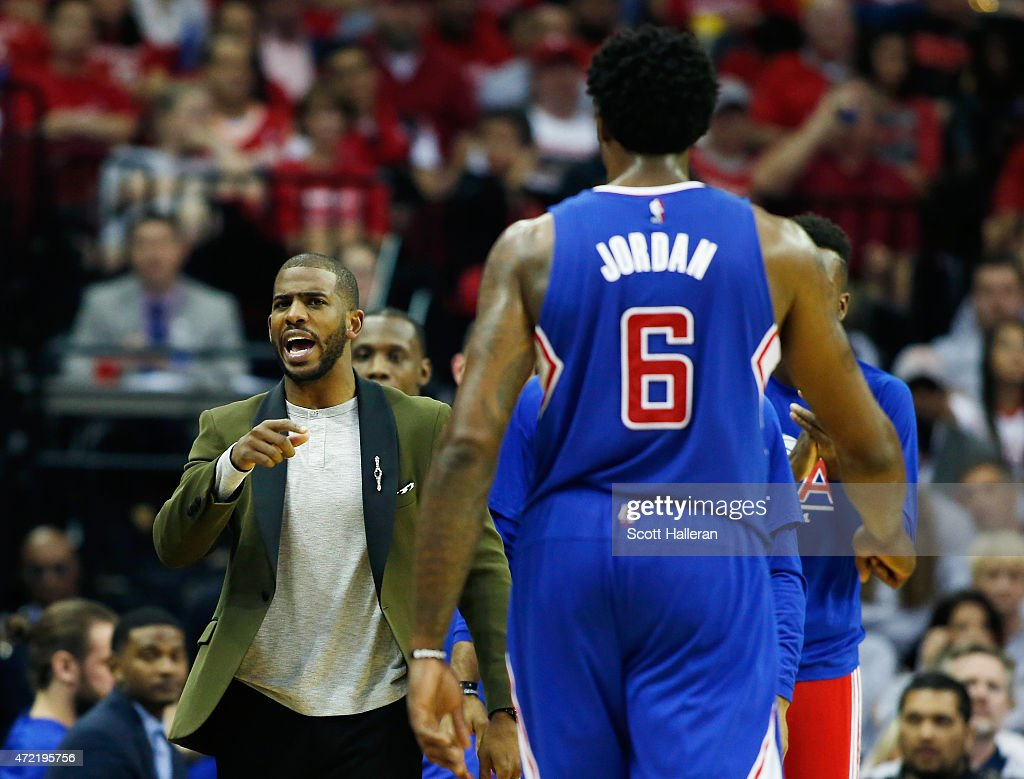 <a gi-track='captionPersonalityLinkClicked' href=/galleries/search?phrase=Chris+Paul&family=editorial&specificpeople=212762 ng-click='$event.stopPropagation()'>Chris Paul</a> #3 of the Los Angeles Clippers (L) greets <a gi-track='captionPersonalityLinkClicked' href=/galleries/search?phrase=DeAndre+Jordan&family=editorial&specificpeople=4665718 ng-click='$event.stopPropagation()'>DeAndre Jordan</a> #6 near the bench late in their game against the Houston Rockets during Game One in the Western Conference Semifinals of the 2015 NBA Playoffs on May 4, 2015 at the Toyota Center in Houston, Texas.
