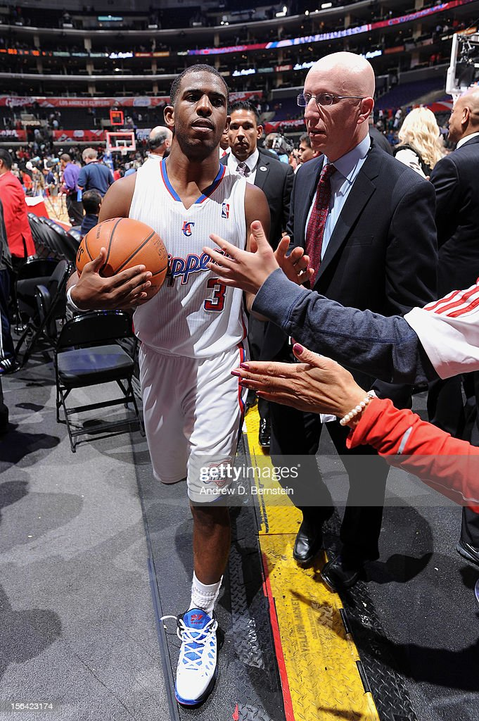 <a gi-track='captionPersonalityLinkClicked' href=/galleries/search?phrase=Chris+Paul&family=editorial&specificpeople=212762 ng-click='$event.stopPropagation()'>Chris Paul</a> #3 of the Los Angeles Clippers greets fans following his team's victory against the Miami Heat at the Staples Center on November 14, 2012 in Los Angeles, California.