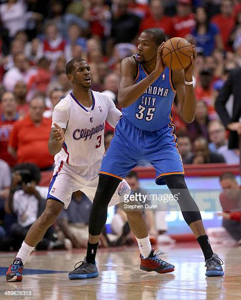 Chris Paul of the Los Angeles Clippers guards Kevin Durant of the Oklahoma City Thunder during the fourth quarter of Game Four of the Western...