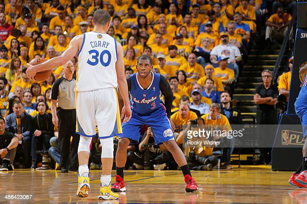 Chris Paul of the Los Angeles Clippers guards Stephen Curry of the Golden State Warriors in Game Four of the Western Conference Quarterfinals during...
