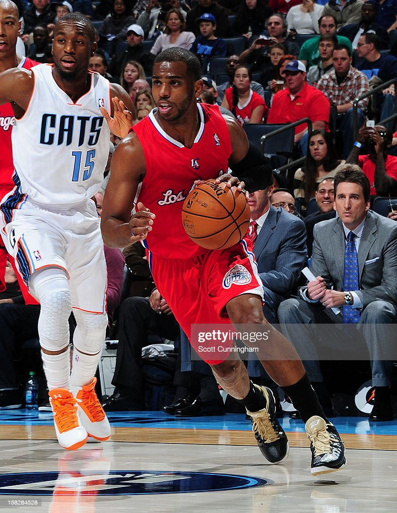 Chris Paul #3 of the Los Angeles Clippers handles the ball against Kemba Walker #15 of the Charlotte Bobcats at Time Warner Cable Arena on December 12, 2012 in Charlotte, North Carolina.