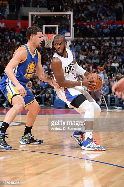 Chris Paul of the Los Angeles Clippers handles the ball against Klay Thompson of the Golden State Warriors on November 19 2015 at STAPLES Center in...