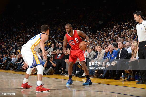 Chris Paul of the Los Angeles Clippers handles the ball against Stephen Curry of the Golden State Warriors on November 4 2015 at ORACLE Arena in...