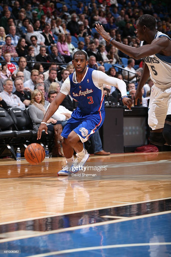 <a gi-track='captionPersonalityLinkClicked' href=/galleries/search?phrase=Chris+Paul&family=editorial&specificpeople=212762 ng-click='$event.stopPropagation()'>Chris Paul</a> #3 of the Los Angeles Clippers handles the ball against the Minnesota Timberwolves on March 31, 2014 at Target Center in Minneapolis, Minnesota.