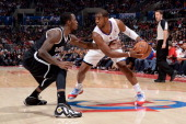Chris Paul of the Los Angeles Clippers handles the basketball while being contested by Tyshawn Taylor of the Brooklyn Nets on November 16 2013 at...