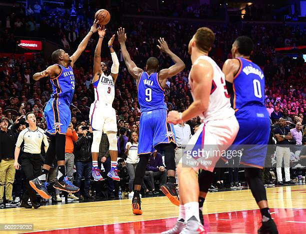 Chris Paul of the Los Angeles Clippers has his last second shot blocked by Kevin Durant of the Oklahoma City Thunder resulting in a 10099 Thunder win...
