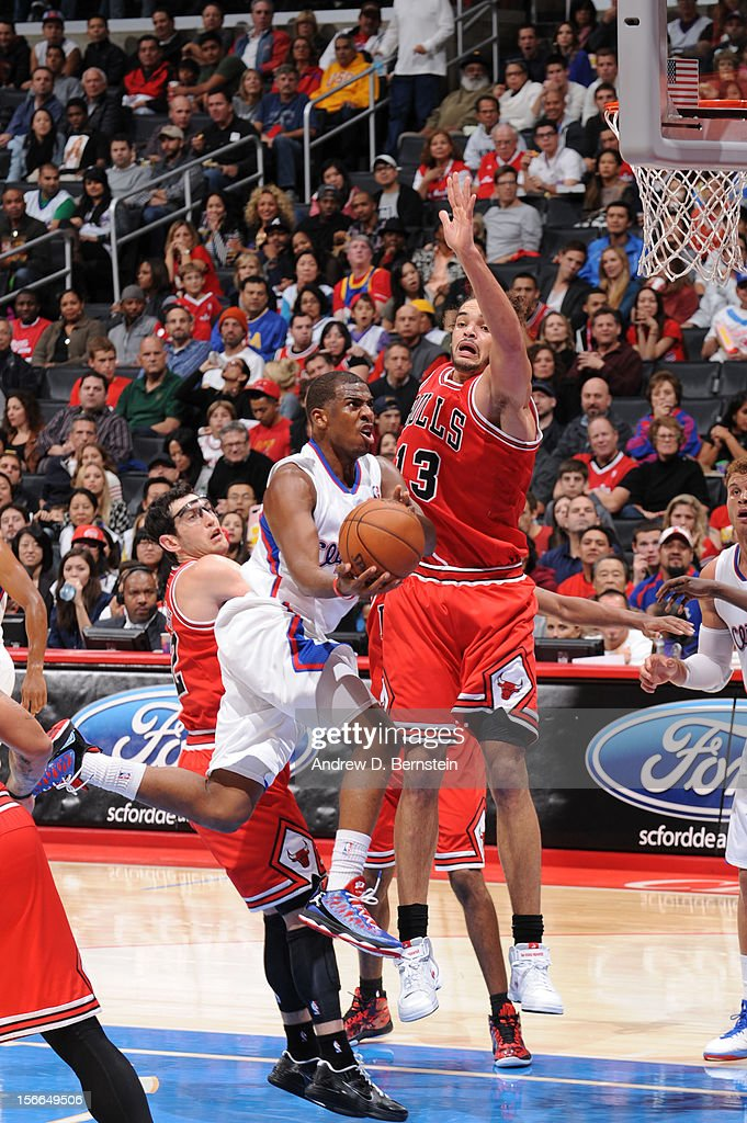 <a gi-track='captionPersonalityLinkClicked' href=/galleries/search?phrase=Chris+Paul&family=editorial&specificpeople=212762 ng-click='$event.stopPropagation()'>Chris Paul</a> #3 of the Los Angeles Clippers has his shot challenged by <a gi-track='captionPersonalityLinkClicked' href=/galleries/search?phrase=Joakim+Noah&family=editorial&specificpeople=699038 ng-click='$event.stopPropagation()'>Joakim Noah</a> #13 of the Chicago Bulls at Staples Center on November 17, 2012 in Los Angeles, California.