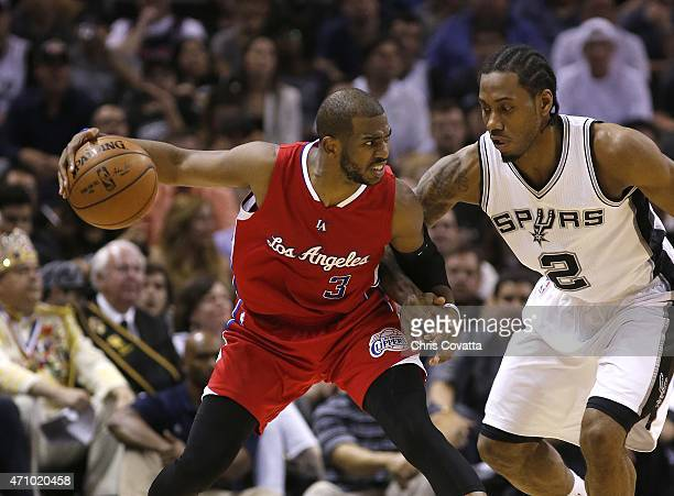 Chris Paul of the Los Angeles Clippers holds the ball away from Kawhi Leonard of the San Antonio Spurs in Game Three during the first round of the...