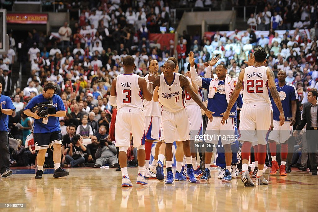 Chris Paul #3 of the Los Angeles Clippers is congratulated by teammates during the game between the Los Angeles Clippers and the Brooklyn Nets at Staples Center on March 23, 2013 in Los Angeles, California.