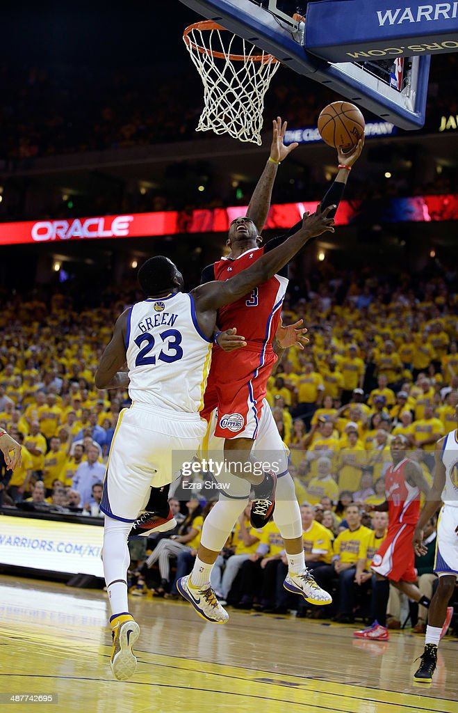 Chris Paul #3 of the Los Angeles Clippers is fouled by Draymond Green #23 of the Golden State Warriors in Game Six of the Western Conference Quarterfinals during the 2014 NBA Playoffs at ORACLE Arena on May 1, 2014 in Oakland, California.