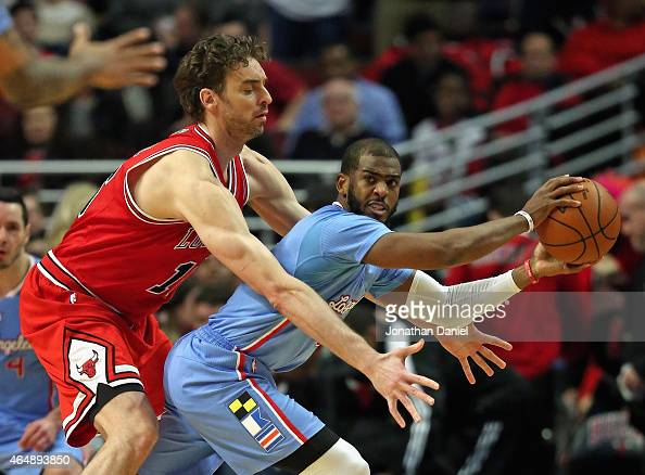 Chris Paul of the Los Angeles Clippers is trapped by Pau Gasol of the Chicago Bulls at the United Center on March 1 2015 in Chicago Illinois The...