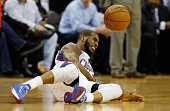 Chris Paul of the Los Angeles Clippers is tripped up on the court during their game against the Houston Rockets at the Toyota Center on February 25...