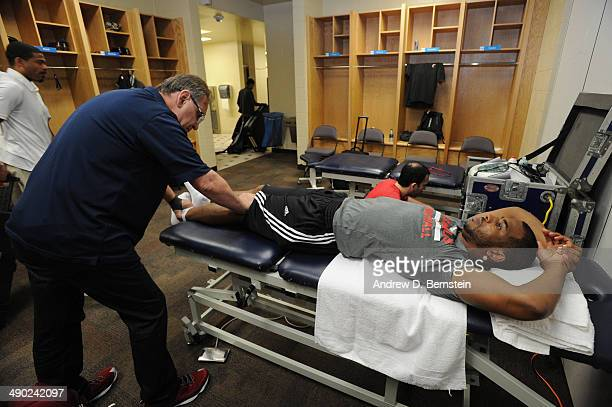Chris Paul of the Los Angeles Clippers is worked on in the locker room before Game Five of the Western Conference Semifinals against the Oklahoma...