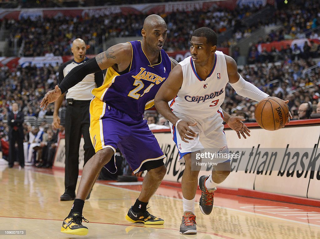 Chris Paul #3 of the Los Angeles Clippers keeps his dribble away from Kobe Bryant #24 of the Los Angeles Lakers during a 107-102 Clipper win at Staples Center on January 4, 2013 in Los Angeles, California.