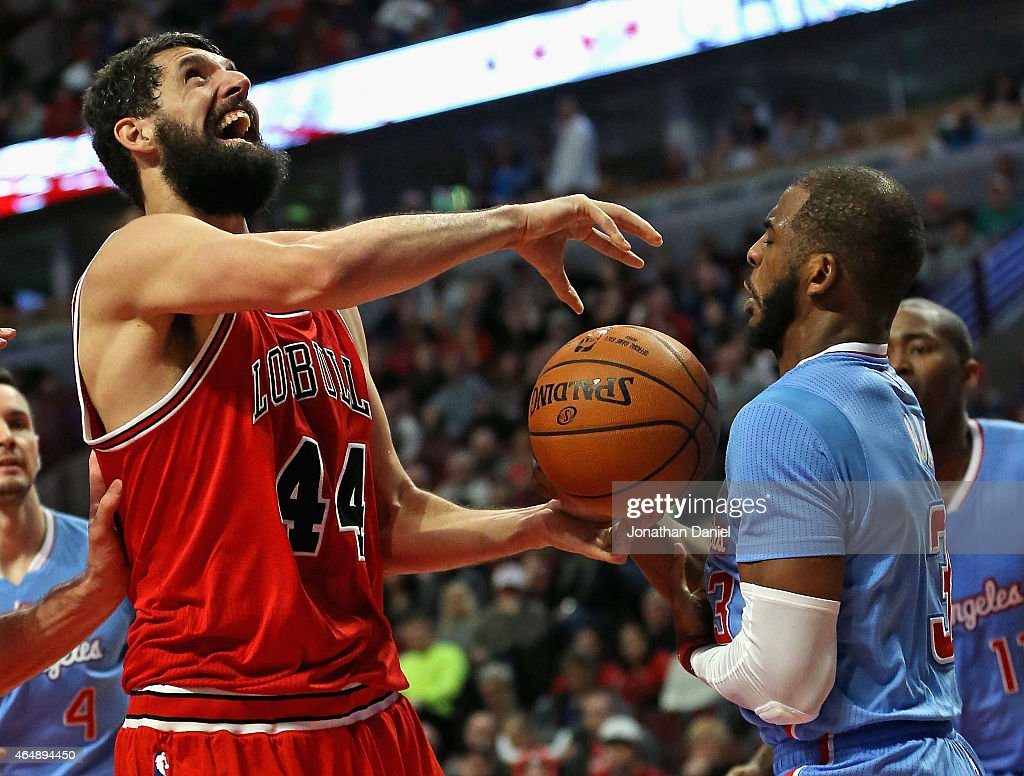 Chris Paul #3 of the Los Angeles Clippers knocks the ball away from Nikola Mirotic #44 of the Chicago Bulls at the United Center on March 1, 2015 in Chicago, Illinois. The Clippers defeated the Bulls 96-86.