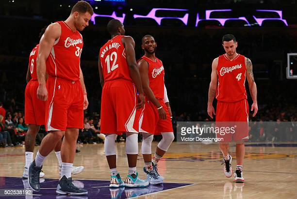 Chris Paul of the Los Angeles Clippers looks on with teammates in the second half of their NBA game against the Los Angeles Lakers at Staples Center...