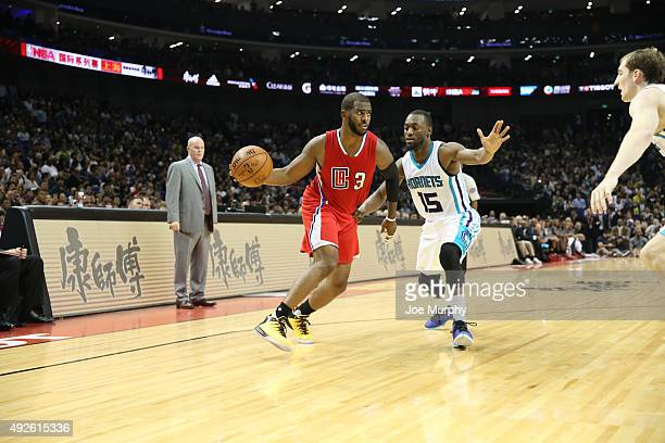 Chris Paul of the Los Angeles Clippers looks to drive against Kemba Walker of the Charlotte Hornets as part of the 2015 NBA Global Games China at the...