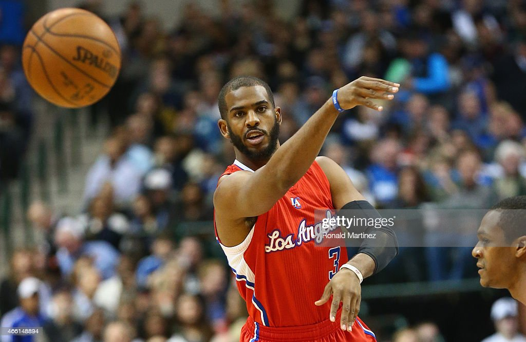 Chris Paul of the Los Angeles Clippers passes the ball against Rajon Rondo of the Dallas Mavericks at American Airlines Center on March 13 2015 in...
