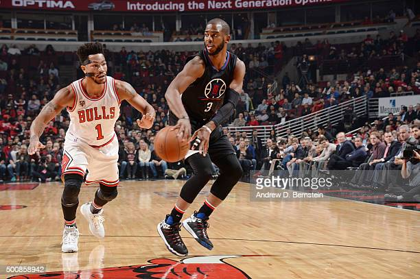 Chris Paul of the Los Angeles Clippers passes the ball against Derrick Rose of the Chicago Bulls on December 10 2015 at the United Center in Chicago...