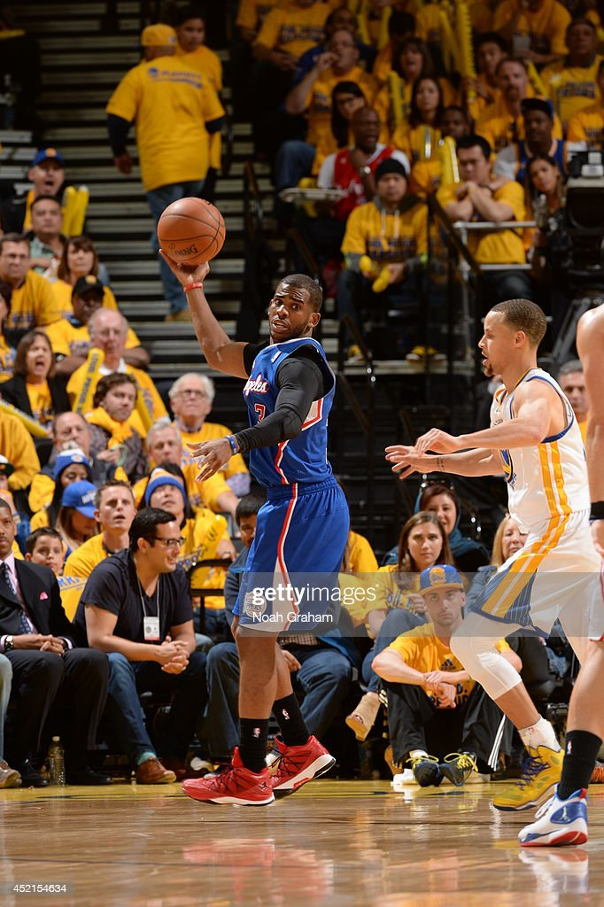 <a gi-track='captionPersonalityLinkClicked' href=/galleries/search?phrase=Chris+Paul&family=editorial&specificpeople=212762 ng-click='$event.stopPropagation()'>Chris Paul</a> #3 of the Los Angeles Clippers passes the ball against the Golden State Warriors in Game Four of the Western Conference Quarterfinals at Oracle Arena on April 27, 2014 in Oakland, California.