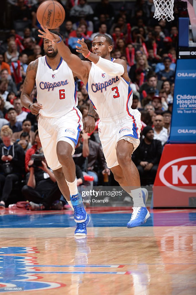 Chris Paul of the Los Angeles Clippers passes the ball during the game against the Minnesota Timberwolves on December 1 2014 at STAPLES CENTER in Los...