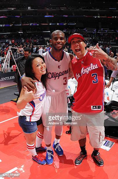 Chris Paul of the Los Angeles Clippers poses for a picture with fans before a game against the Memphis Grizzlies on April 11 2015 at Staples Center...