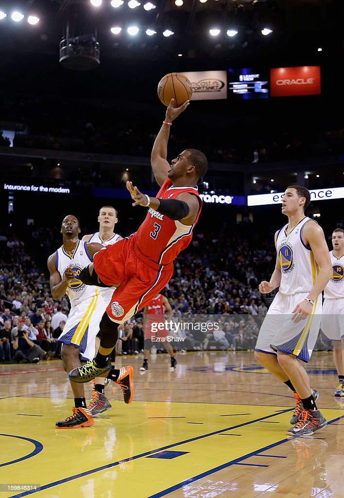 Chris Paul #3 of the Los Angeles Clippers puts up a shot after being fouled by the Golden State Warriors at Oracle Arena on January 21, 2013 in Oakland, California.