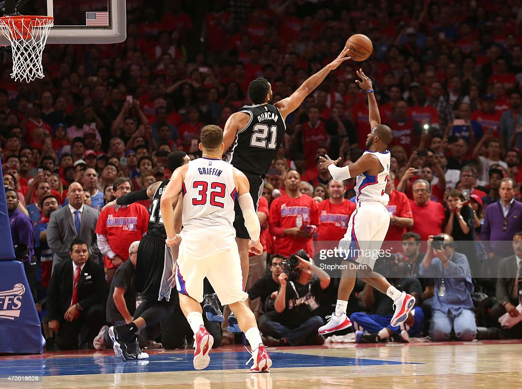 Chris Paul #3 of the Los Angeles Clippers puts up the game winning shot over Tim Duncan #21 of the San Antonio Spurs with one second remaining in Game Seven of the Western Conference quarterfinals the 2015 NBA Playoffs as Clipper Blake Griffin stands by at Staples Center on May 2, 2015 in Los Angeles, California. The Clippers won 111-109 to win the series four games to three.