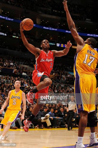 Chris Paul of the Los Angeles Clippers rises for a shot against Andrew Bynum of the Los Angeles Lakers at Staples Center on December 19 2011 in Los...
