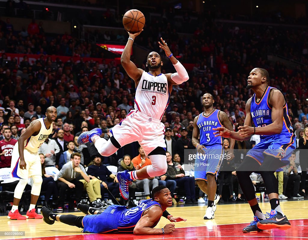 Chris Paul of the Los Angeles Clippers scores off of an inbound steal to Russell Westbrook of the Oklahoma City Thunder as Kevin Durant and Dion...