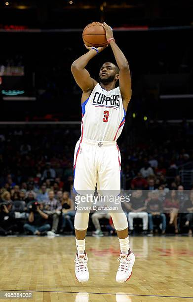 Chris Paul of the Los Angeles Clippers shoots a three point shot against Portland Trail Blazers during the first quarter of the preseason basketball...