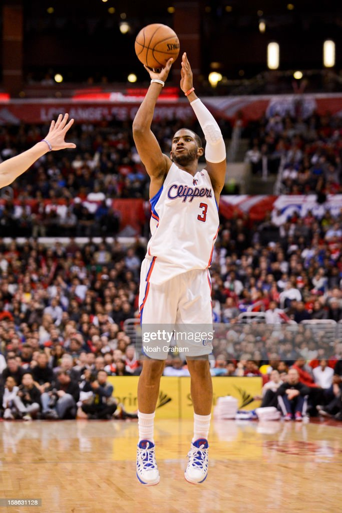 Chris Paul #3 of the Los Angeles Clippers shoots a three-pointer against the Sacramento Kings at Staples Center on December 21, 2012 in Los Angeles, California.