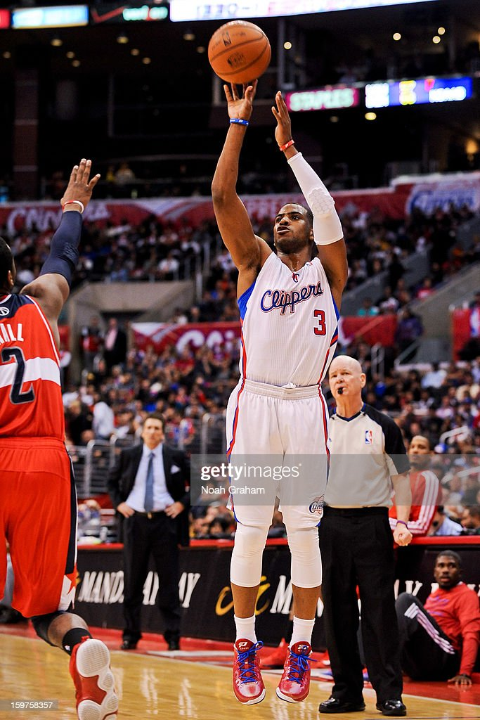 Chris Paul #3 of the Los Angeles Clippers shoots a three-pointer against the Washington Wizards at Staples Center on January 19, 2013 in Los Angeles, California.