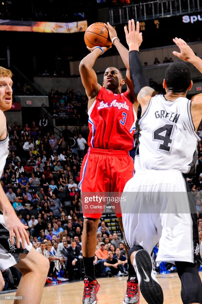 Chris Paul #3 of the Los Angeles Clippers shoots against Danny Green #4 of the San Antonio Spurs on November 19, 2012 at the AT&T Center in San Antonio, Texas.