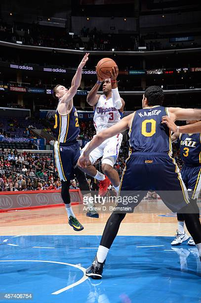 Chris Paul of the Los Angeles Clippers shoots against Gordon Hayward and Enes Kanter of the Utah Jazz during the game on October 17 2014 at the...