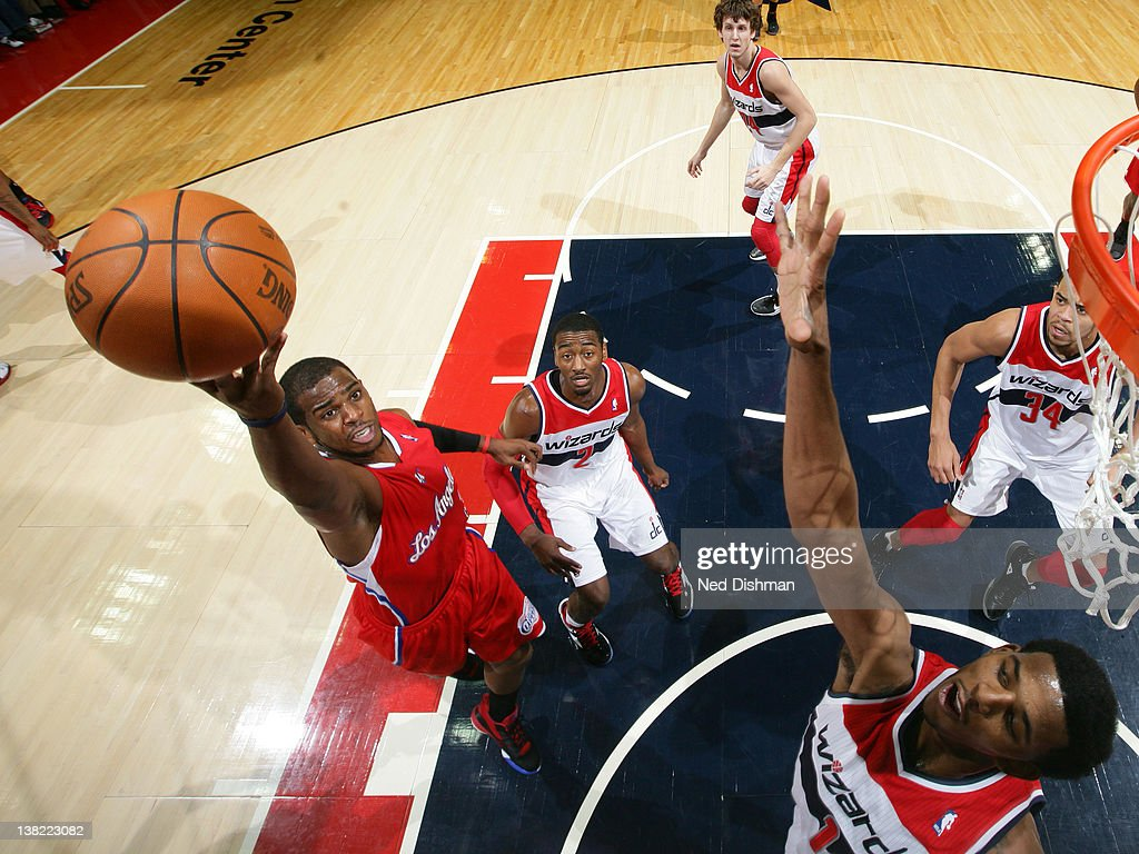 <a gi-track='captionPersonalityLinkClicked' href=/galleries/search?phrase=Chris+Paul&family=editorial&specificpeople=212762 ng-click='$event.stopPropagation()'>Chris Paul</a> #3 of the Los Angeles Clippers shoots against <a gi-track='captionPersonalityLinkClicked' href=/galleries/search?phrase=John+Wall&family=editorial&specificpeople=2265812 ng-click='$event.stopPropagation()'>John Wall</a> #2 and Nick Young #1 of the Washington Wizards during the game at the Verizon Center on February 4, 2012 in Washington, DC.