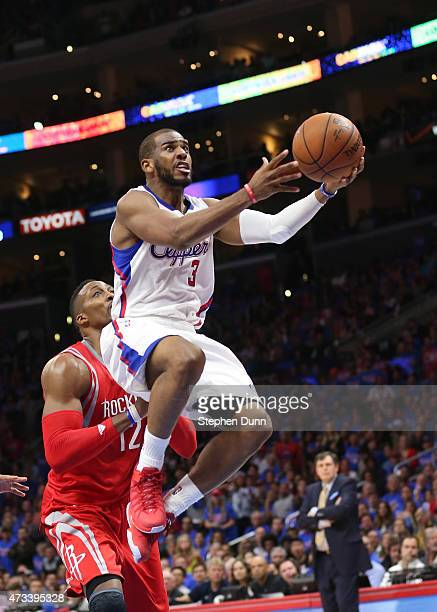 Chris Paul of the Los Angeles Clippers shoots over Dwight Howard of the Houston Rockets during Game Six of the Western Conference semifinals of the...