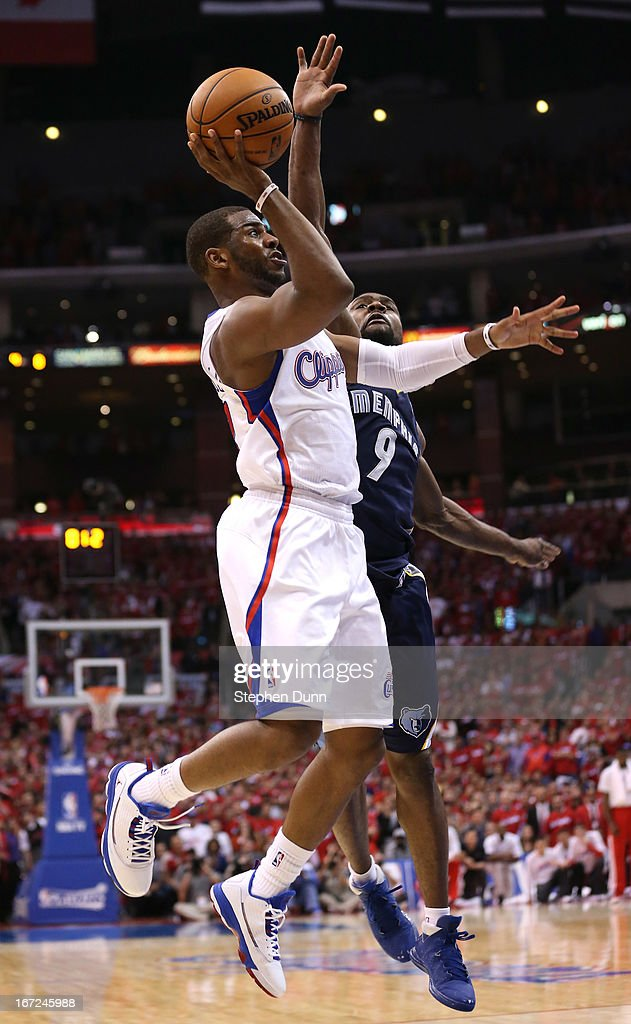 <a gi-track='captionPersonalityLinkClicked' href=/galleries/search?phrase=Chris+Paul&family=editorial&specificpeople=212762 ng-click='$event.stopPropagation()'>Chris Paul</a> #3 of the Los Angeles Clippers shoots the game winning shot with a tenth of a second left in the game over <a gi-track='captionPersonalityLinkClicked' href=/galleries/search?phrase=Tony+Allen&family=editorial&specificpeople=201665 ng-click='$event.stopPropagation()'>Tony Allen</a> #9 of the Memphis Grizzlies during Game Two of the Western Conference Quarterfinals of the 2013 NBA Playoffs at Staples Center on April 22, 2013 in Los Angeles, California. The Clippers won 93-91.